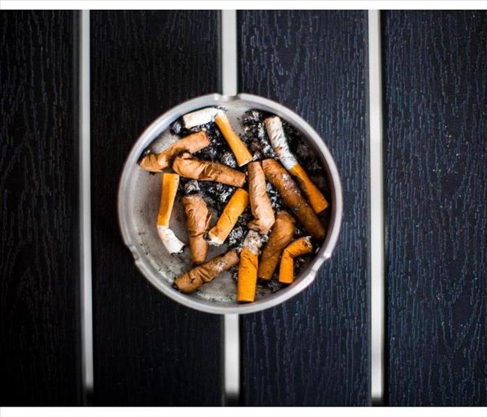 An ashtray with smoked cigarettes